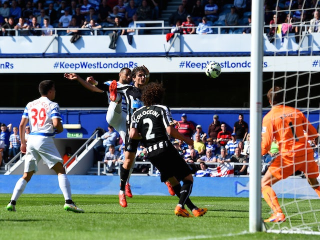 Matt Philips of QPR scores their first goal under pressure from Fabricio Coloccini of Newcastle United during the Barclays Premier League match between Queens Park Rangers and Newcastle United at Loftus Road on May 16, 2015