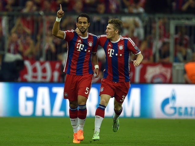 Bayern Munich's Moroccan defender Medhi Benatia (L) and Bayern Munich's midfielder Bastian Schweinsteiger react after a goal during the UEFA Champions League football match second leg semi final FC Bayern Munich vs FC Barcelona in Munich on May 12, 2015