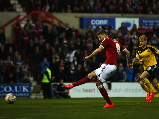 Michael Smith of Swindon Town scores from a penalty during the Sky Bet League 1 Playoff Semi-Final between Swindon Town and Sheffiled United at County Ground on May 11, 2015