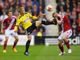 Jake Bidwell of Brentford challenges Adam Clayton of Middlesbrough during the Sky Bet Championship Playoff semi final second leg match between Middlesbrough and Brentford at the Riverside Stadium on May 15, 2015