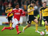Nathan Byrne of Swindon Town tackles Ryan Flynn of Sheffield United during the Sky Bet League 1 Playoff Semi-Final between Swindon Town and Sheffiled United at County Ground on May 11, 2015