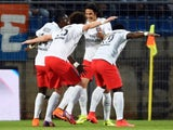 Paris Saint-Germain's players congratulate their French midfielder Blaise Matuidi (L) after he scored a goal during the French L1 football match between Montpellier (MHSC) and Paris Saint-Germain (PSG) on May 16, 2015