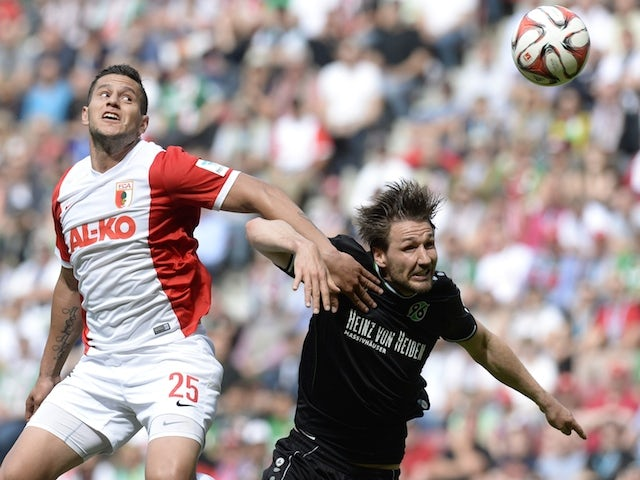 Augsburg's Argentinian striker Raul Bobadilla (L) and Hanover's defender Christian Schulz (R) vie for the ball during the German first division Bundesliga football match FC Augsburg vs Hannover 96 in Augsburg, southern Germany, on May 16, 2015