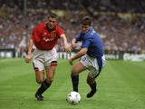 Roy Keane (left) of Manchester United and Andy Hinchcliffe (right) of Everton both race for the ball during the FA Cup Final at Wembley Stadium in London on May 20, 1995