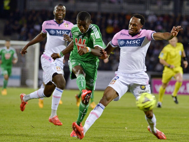 Saint-Etienne's Ivorian forward Max-Alain Gradel shoots to score between Evian's Congolese defender Cedric Mongongu and Evian's Comorian defender Kassim Abdallah during the French L1 football match between Evian Thonon Gaillard (ETG) and Saint-Etienne (AS