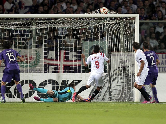 Carlos Bacca #9 of FC Sevilla scores the opening goal during the UEFA Europa League Semi Final match between ACF Fiorentina and FC Sevilla on May 14, 2015