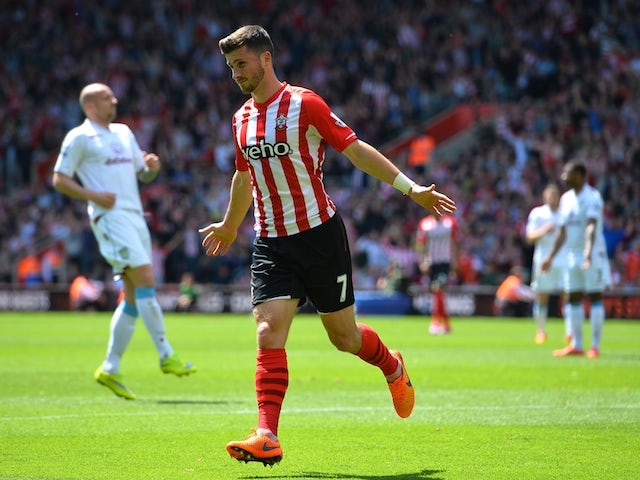 Southampton's Irish striker Shane Long celebrates scoring their fourth goal during the English Premier League football match between Southampton and Aston Villa at St Mary's Stadium in Southampton, southern England on May 16, 2015
