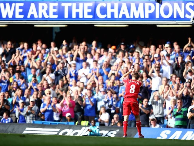 Steven Gerrard applauds the supporters as he leaves the field during the 1-1 draw between Chelsea and Liverpool at Stamford Bridge on May 10, 2015