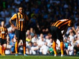 A dejected Tom Huddlestone of Hull City looks on during the Barclays Premier League match between Tottenham Hotspur and Hull City at White Hart Lane on May 16, 2015