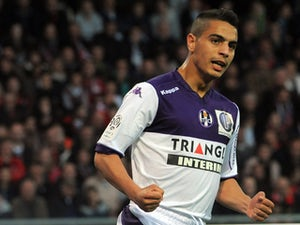 Toulouse's French Tunisian forward Wissam Ben Yedder jubilates after scoring during the French L1 football match Guingamp versus Toulouse on May 16, 2015