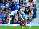 Romelu Lukaku of Everton and Winston Reid of West Ham compete for the ball during the Barclays Premier League match between West Ham United and Everton at Boleyn Ground on May 16, 2015
