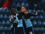 Alfie Mawson of Wycombe Wanderers (26) celebrates with team mates as he scores their second goal during the Sky Bet League Two Playoff semi final match between Wycombe Wanderers and Plymouth Argyle at Adams Park on May 14, 2015