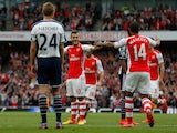 Jack Wilshere of Arsenal celbrates scoring his team's third goal with his team mate Theo Walcott during the Barclays Premier League match between Arsenal and West Bromwich Albion at Emirates Stadium on May 24, 2015