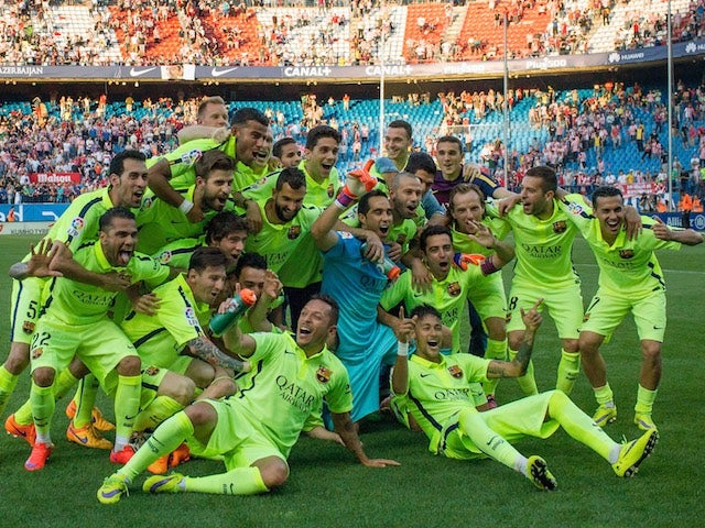 Barcelona players celebrate at the Vicente Calderon after beating Atletico Madrid 1-0 to clinch the 2014-15 La Liga title on May 17, 2015