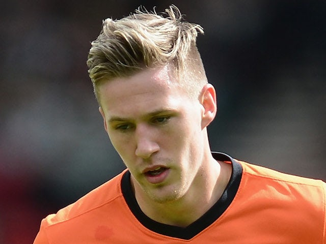 Barry Douglas of Dundee United in action during The William Hill Scottish Cup Semi Final between Dundee United and Celtic at Hampden Park on April 14, 2013