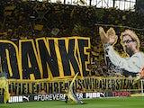 Dortmund's fans celebrate Dortmund's head coach Juergen Klopp prior to German first division Bundesliga football match between Borussia Dortmund and SV Werder Bremen at the Signal Iduna Park in Dortmund, western Germany on May 23, 2015