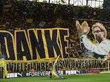 Dortmund's fans celebrate Dortmund's head coach Juergen Klopp prior to German first division Bundesliga football match between Borussia Dortmund and SV Werder Bremen at the Signal Iduna Park in Dortmund, western Germany on May 23, 2015