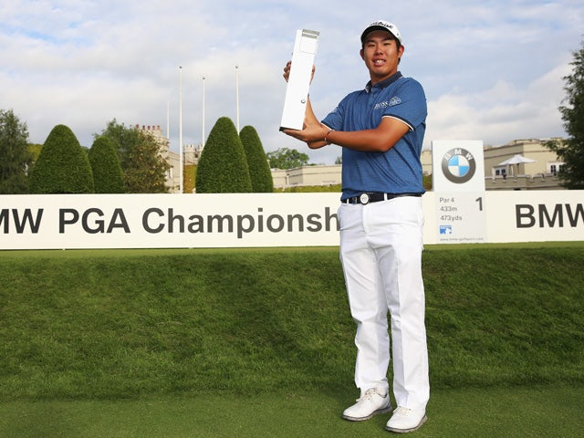 Byeong-Hun An of South Korea holds the trophy following his victory during day 4 of the BMW PGA Championship at Wentworth on May 24, 2015