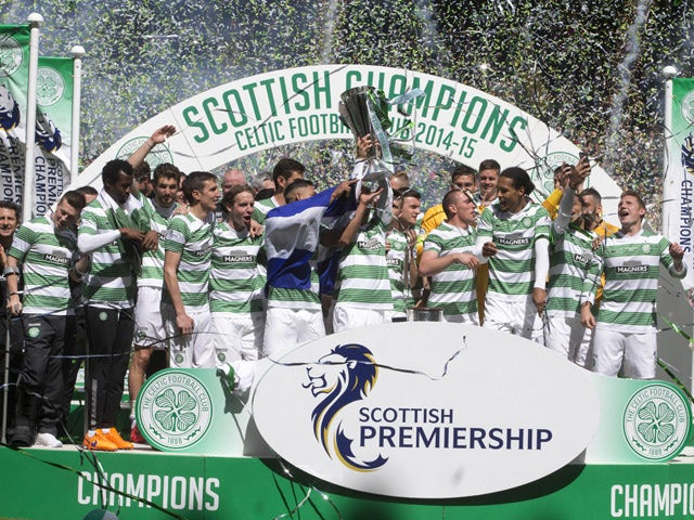 Champions Celtic lift the trophy after winning the Scottish Premiership Match between Celtic and Inverness Caley Thistle at Celtic Park on May 24, 2015
