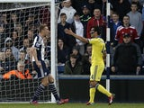 Cesc Fabregas (R) remonstrates with West Bromwich Albion's Scottish midfielder Darren Fletcher (C), resulting in a red card for Fabregas during the English Premier League football match between West Bromwich Albion and Chelsea at The Hawthorns in West Bro