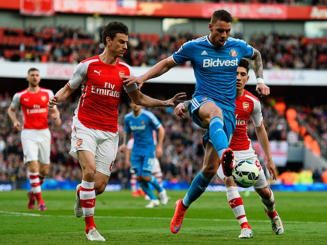 Connor Wickham of Sunderland holds off Laurent Koscielny of Arsenal during the Barclays Premier League match between Arsenal and Sunderland at Emirates Stadium on May 20, 2015