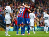 Marouane Chamakh of Crystal Palace celebrates scoring his team's first goal with his team mate Joel Ward during the Barclays Premier League match between Crystal Palace and Swansea City at Selhurst Park on May 24, 2015