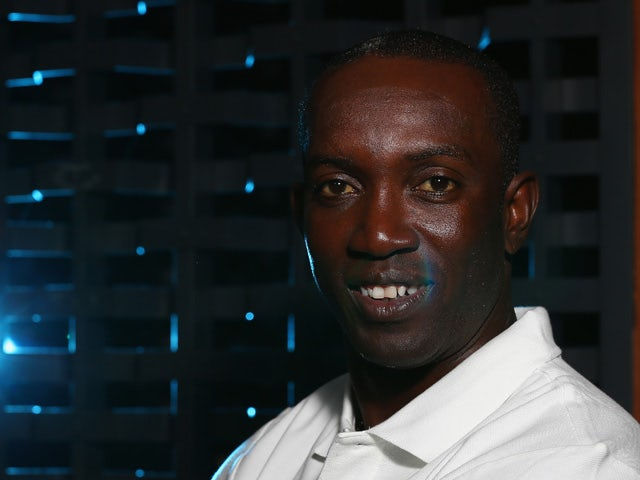 Dwight Yorke poses during a Global Legends Series portrait session at the Swissotel on December 5, 2014