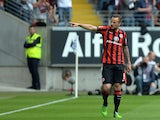 Frankfurt's Swiss forward Haris Seferovic celebrates scoring the opening goal during German first division Bundesliga football match between Eintracht Frankfurt and Bayer 04 Leverkusen at the Commerzbank Arena in Frankfurt am Main, western Germany on May