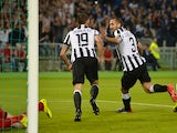 Juventus' defender Giorgio Chiellini (R) celebrates after scoring during the Italian Tim Cup final match (Coppa Italia) between Juventus and Lazio on May 20, 2015