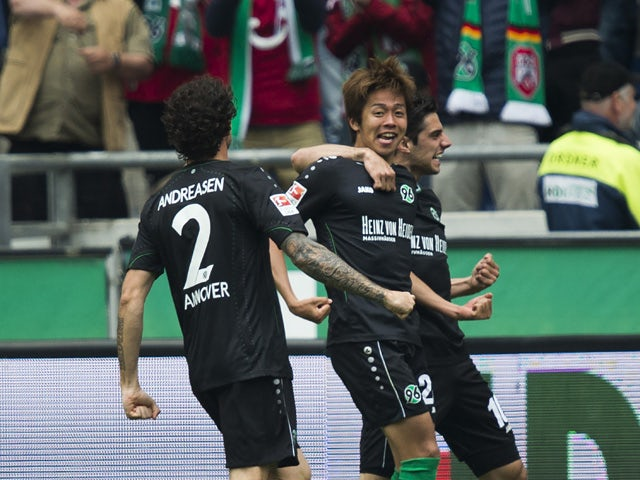 Hannover's Japanese midfielder Hiroshi Kiyotake celebrates scoring the opening goal during German first division Bundesliga football match Hannover 96 vs SC Freiburg at the HDI-Arena in Hanover, northern Germany on May 23, 2015