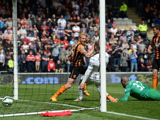 The ball goes into the Manchester United goal past Manchester United's Spanish goalkeeper Víctor Valdes and Manchester United's English striker Wayne Roone but the goal is disallowed for offside during the English Premier League football match between