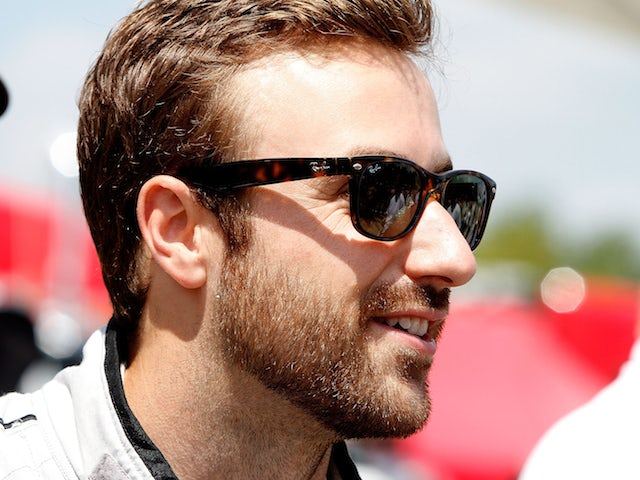 James Hinchcliffe is shown on the grid before the IMSA Tudor Series race at Road America on August 10, 2014