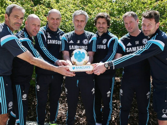 Jose Mourinho and his backroom staff pose with his Manager of the Season award for 2014-15