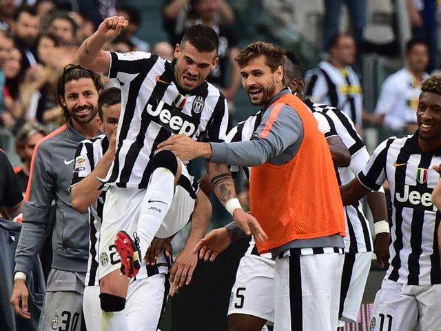 Juventus' midfielder Stefano Sturaro celebrates after scoring during the Italian Serie A football match Juventus vs Napoli on May 23, 2015