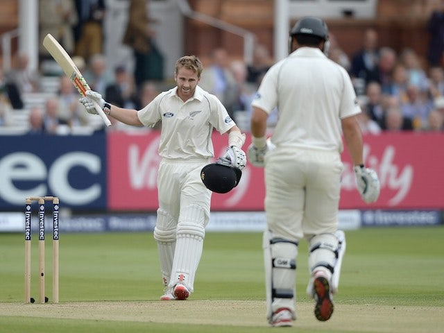 New Zealand's Kane Williamson celebrates reaching his century on the third day of the First Test with England on May 23, 2015