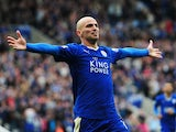 Esteban Cambiasso of Leicester City celebrates scoring his team's fourth goal during the Barclays Premier League match between Leicester City and Queens Park Rangers at The King Power Stadium on May 24, 2015