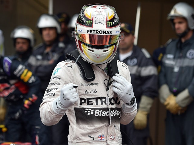 Mercedes AMG Petronas F1 Team's British driver Lewis Hamilton reacts as he celebrates taking the pole position in the parc fermee after the qualifying session at the Monaco street circuit in Monte-Carlo on May 23, 2015