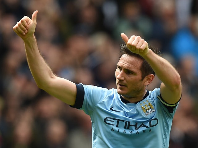 Manchester City's English midfielder Frank Lampard celerbates scoring the opening goal during the English Premier League football match between Manchester City and Southampton at the Etihad Stadium in Manchester, northwest England on May 24, 2015