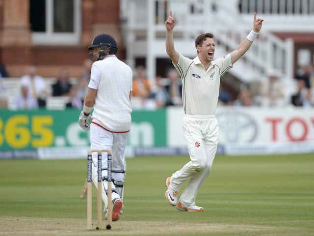 Matt Henry of New Zealand celebrates dismissing Joe Root of England during day four of 1st Investec Test match between England and New Zealand at Lord's Cricket Ground on May 24, 2015