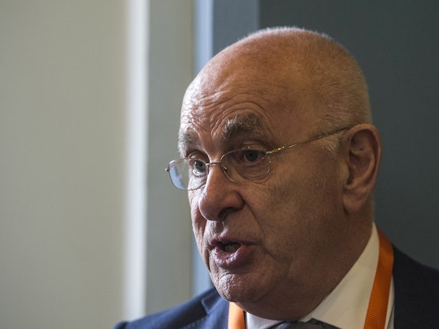 The president of the Dutch Football Federation, Michael van Praag answers AFP journalists' questions during the 37th Confederation of African Football (CAF) Ordinary General Assembly on April 7, 2015