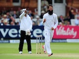 Moeen Ali celebrates taking the wicket of Tom Latham during day two of the First Test between England and New Zealand on May 22, 2015