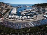 General view as the cars round the harbour and swimming pool complex during practice for the Monaco Formula One Grand Prix at the Circuit de Monaco on May 23, 2013