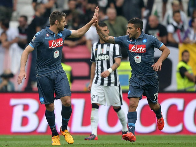 Napoli's midfielder from Uruguay Walter Gargano celebrates with Napoli's midfielder from Spain David Lopez after scoring during the Italian Serie A football match Juventus vs Napoli on May 23, 2015