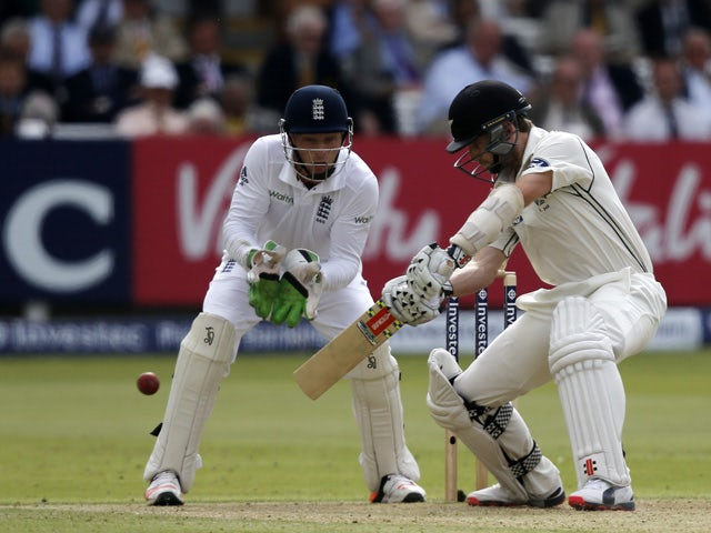 New Zealand batsman Kane Williamson plays a shot in front of England wicket keeper Jos Buttler during the second day of the first cricket Test match between England and New Zealand at Lord's cricket ground in London on May 22, 2015