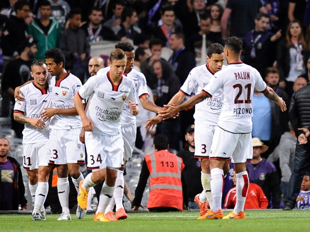 Nice's Eric Bautheac is congratulated by teammates after scoring a goal during the French L1 football match Toulouse vs Guigamp on December 20, 2015