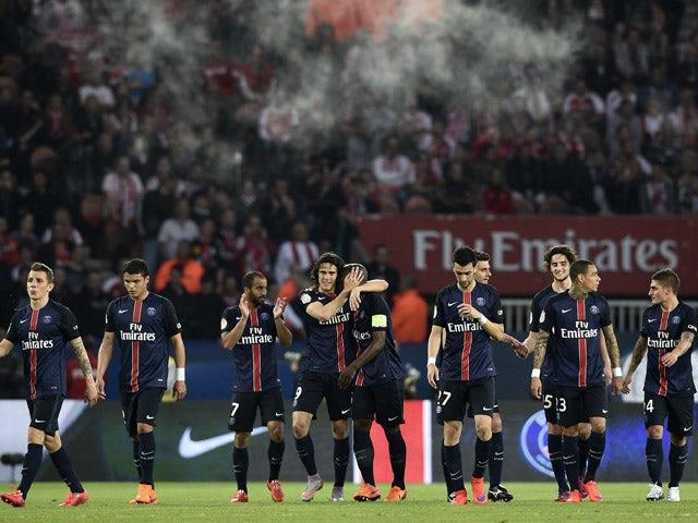 Paris Saint-Germain's Uruguyan forward Edinson Cavani is congratulated by teammates after his goal during the French L1 football match between Paris Saint-Germain (PSG) vs Reims on May 23, 2015