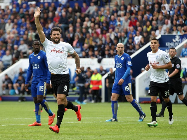 Charlie Austin of QPR celebrates after scoring his team's first goal of the game during the Barclays Premier League match between Leicester City and Queens Park Rangers at The King Power Stadium on May 24, 2015