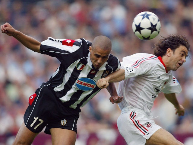 Milan AC forward Portuguese Rui Costa (R) and Juventus' forward French David Trezeguet head off the ball during their European Champions League Final match at Old Trafford Stadium, 28 May 2003