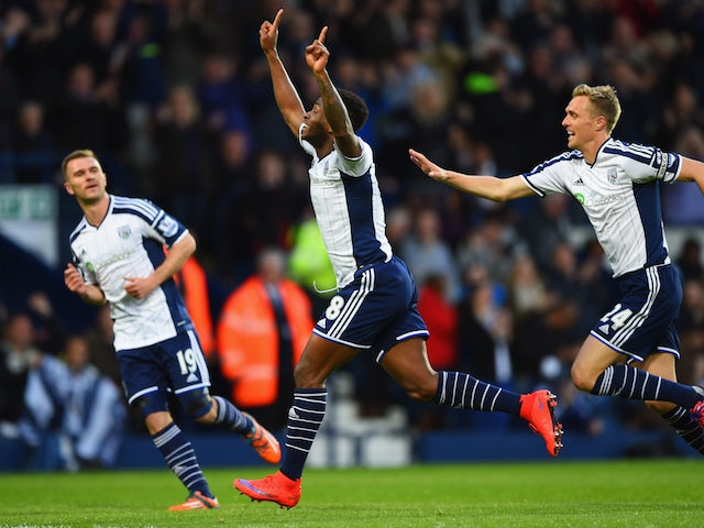 Saido Berahino of West Bromwich Albion (18) celebrates with team mates Callum McManaman (19) and Darren Fletcher (24) as he scores their first goal during the Barclays Premier League match between West Bromwich Albion and Chelsea at The Hawthorns on May 1