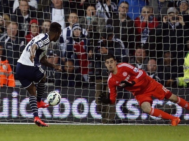 West Bromwich Albion's striker Saido Berahino scores from the penalty spot during the English Premier League football match between West Bromwich Albion and Chelsea at The Hawthorns in West Bromwich, central England, on May 18, 2015